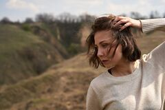 Portrait of beautiful girl on the nature background with hills and sky, , fashion photography