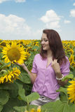 Portrait of a beautiful girl on nature. Beautiful girl in a field of sunflowers Stock Photography