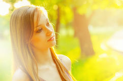 Portrait of beautiful girl in nature on sunny spring day Royalty Free Stock Image