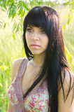 Portrait of beautiful girl in nature on warm summer day. Portrait of the beautiful girl in the nature on warm summer day royalty free stock photo