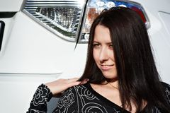 Portrait beautiful girl near white car Stock Images