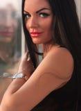 Portrait of a beautiful girl near a window Royalty Free Stock Image
