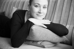 Calm young girl. Relaxing on couch,  open eyes, monochrome soft focus portrait Stock Photos