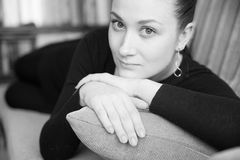 Beautiful girl. Cute young woman on a pillow at home, soft focus portrait, wide open eyes Royalty Free Stock Image