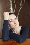 Beautiful girl. Sad young woman with brown eyes at the table. soft focus portrait Stock Photo