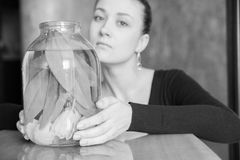 Beautiful girl with flowers. Sad girl with a jar . monochrome Royalty Free Stock Photos