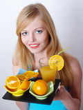 Portrait of beautiful girl with orange and juice Stock Image