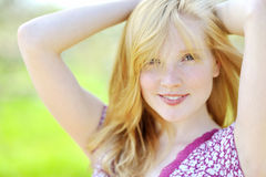 Portrait of a beautiful girl in the park in spring Stock Photography