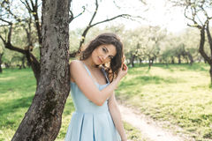 Portrait of a beautiful girl in a park in summer Stock Photography