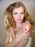 Portrait of beautiful girl with perfume bottle royalty free stock image