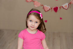 Portrait of a beautiful girl in a pink indoors Royalty Free Stock Image