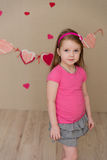 Portrait of a beautiful girl in a pink indoors Royalty Free Stock Photos