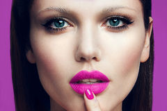 Portrait of beautiful girl with pink lips. Royalty Free Stock Images