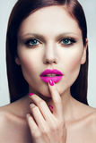 Portrait of beautiful girl with pink lips. Stock Image