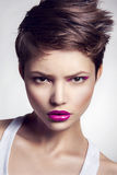 Portrait of beautiful girl with pink lips. Stock Photo