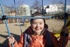 Portrait of beautiful girl on the playground royalty free stock image