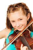 Portrait of beautiful girl playing on violin. Portrait of beautiful girl with long hair holding the fiddlestick and playing on the violin isolated on white Stock Photo