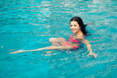 Portrait of a beautiful girl in the pool Royalty Free Stock Photos