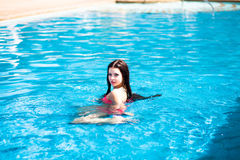 Portrait of a beautiful girl in the pool Royalty Free Stock Image