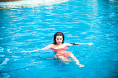 Portrait of a beautiful girl in the pool Royalty Free Stock Photography