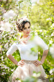 Portrait of beautiful girl posing outdoor with flowers of the cherry trees in blossom during a bright spring day Stock Images