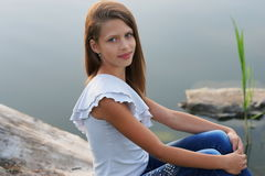 Portrait of a beautiful girl posing outdoors. Near the river Stock Photos
