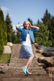 Portrait of beautiful girl posing in the Park. Fashion style skirt jacket Royalty Free Stock Photo