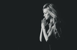 Portrait of a beautiful girl in prayer Royalty Free Stock Image