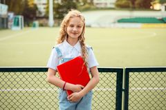 Portrait of a beautiful girl, pretty, blonde with curly hair and blue eyes royalty free stock images