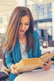 Portrait of a beautiful girl reading book Royalty Free Stock Photo