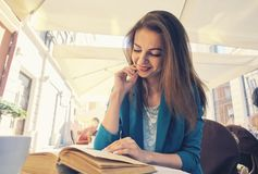 Portrait of a beautiful girl reading book Royalty Free Stock Image