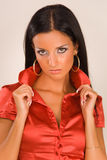 Portrait of a beautiful girl in red blouse. Studio isolated stock photography