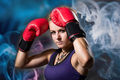 Portrait of beautiful girl with red boxing gloves Royalty Free Stock Photo
