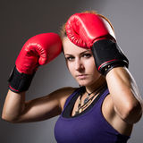 Portrait of beautiful girl with red boxing gloves Stock Photography