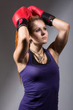 Portrait of beautiful girl with red boxing gloves, looking up Royalty Free Stock Photo
