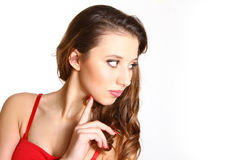 Portrait of beautiful girl in a red dress with makeup isolated o Stock Photo