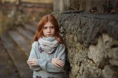 Portrait of a beautiful girl with red hair and freckles offended or angry royalty free stock photo