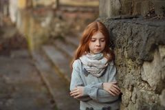 Portrait of a beautiful girl with red hair and freckles sad or pensive. The concept of transitional age and adolescent issues stock photo