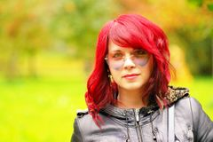 Portrait of a beautiful girl with red hair and heart like glassess Stock Photos