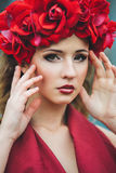 Portrait of beautiful girl with red wreath stock photos