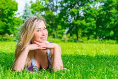 Portrait of a beautiful girl resting on the meadow Royalty Free Stock Image