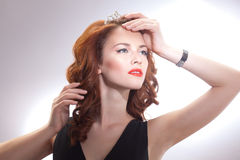 Portrait of a beautiful girl in a retro style in black dress with a crown on his head Stock Photography