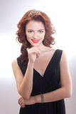 Portrait of a beautiful girl in a retro style in black dress Stock Image