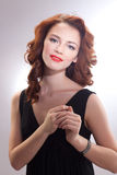 Portrait of a beautiful girl in a retro style in black dress Royalty Free Stock Images