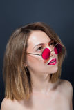 Portrait of beautiful girl in round pink glasses Stock Photos