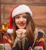 Portrait of beautiful girl in Santa hat looking at the camera Stock Photography