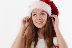Portrait of beautiful girl in Santa hat looking up and dreaming Stock Photography