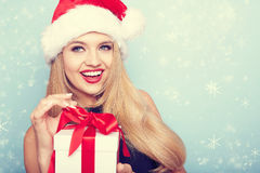 Portrait of beautiful girl with santa hat. Royalty Free Stock Photos
