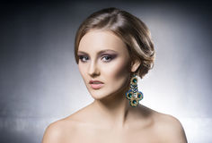 Portrait of beautiful girl in shiny jewels Stock Photography