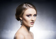 Portrait of beautiful girl in shiny jewels Stock Images